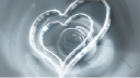 Royalty Free HD Video Clip of Rotating Hearts with a Rose in the Background