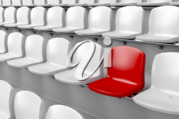 Unique red seat among white ones