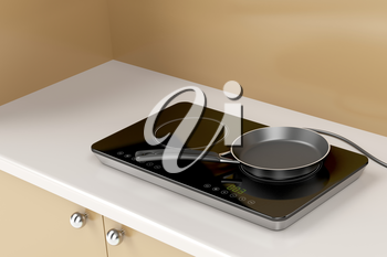Double induction cooktop with frying pan in the kitchen