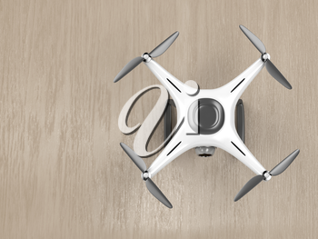 Unmanned aerial vehicle on wood background, top view