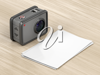 Digital camera and blank photos on the wood table