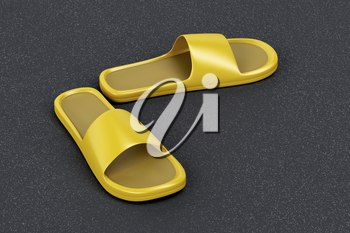 Yellow rubber slides on the asphalt