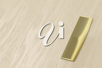 Gold hair comb on wood table