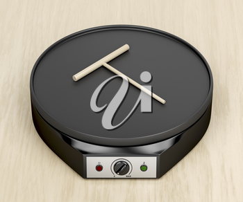 Electric pancake maker and wooden spreader