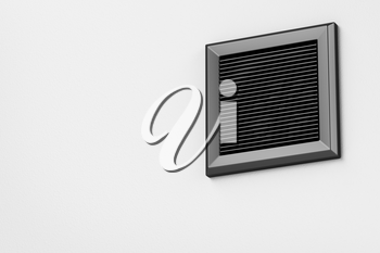 Black electric exhaust fan on the wall