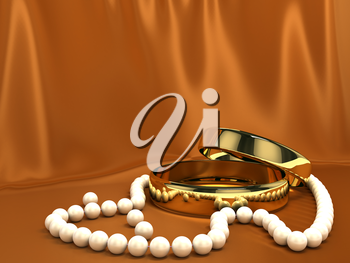 Two gold rings over red silk background