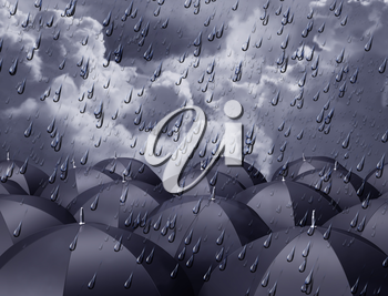 Royalty Free Clipart Image of Umbrellas with Raindrops