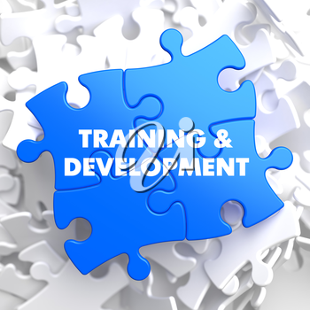 Training and Development Written on Blue Puzzle Pieces. Educational Concept.  3D Render.