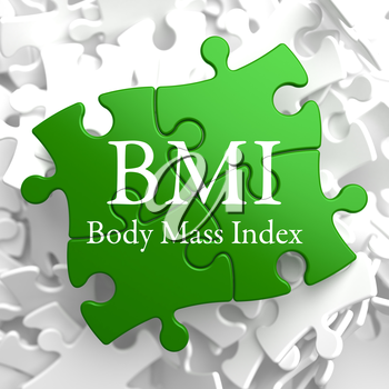 BMI- Body Mass Index - Written on Green Puzzle Pieces. Health Concept.