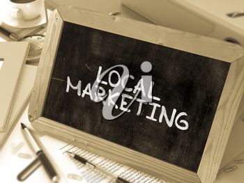 Local Marketing - Chalkboard with Hand Drawn Text, Stack of Office Folders, Stationery, Reports on Blurred Background. Toned Image. 3d Render.