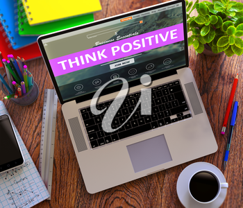 Think Positive Concept. Modern Laptop and Different Office Supply on Wooden Desktop background. 3D Render.