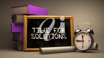 Time for Solutions - Chalkboard with Hand Drawn Text, Stack of Books, Alarm Clock and Rolls of Paper on Blurred Background. Toned Image. 3D Render.