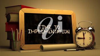 Time to Implementation Handwritten by white Chalk on a Blackboard. Composition with Small Chalkboard and Stack of Books, Alarm Clock and Rolls of Paper on Blurred Background. Toned Image. 3D Render.