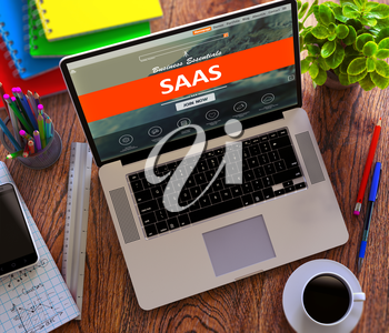 SaaS - Software as a Service - on Laptop Screen. E-Business Concept.