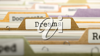 File Folder Labeled as Dreams in Multicolor Archive. Closeup View. Blurred Image. 3D Render.