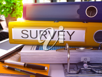 Yellow Ring Binder with Inscription Survey on Background of Working Table with Office Supplies and Laptop. Survey - Toned Illustration. Survey Business Concept on Blurred Background. 3D Render.