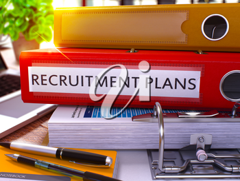Red Office Folder with Inscription Recruitment Plans on Office Desktop with Office Supplies and Modern Laptop. Recruitment Plans Business Concept on Blurred Background. 3D Render.