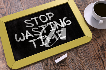 Stop Wasting Time Concept Hand Drawn on Yellow Chalkboard on Wooden Table. Business Background. Top View. 3D Render.