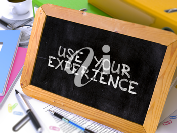 Hand Drawn Use Your Experience Concept  on Chalkboard. Blurred Background. Toned Image. 3D Render.