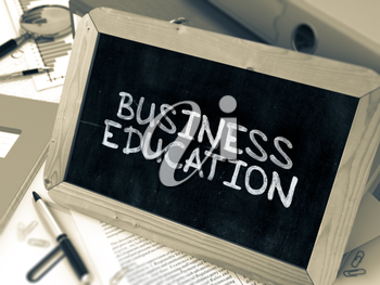 Business Education - Chalkboard with Hand Drawn Text, Stack of Office Folders, Stationery, Reports on Blurred Background. Toned Image. 3D Render.