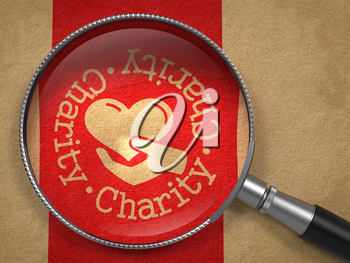 Magnifying Glass with Charity Word Written Arround Icon of Heart in the Hand on Old Paper with Red Vertical Line Background. Social Concept.