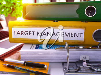Target Management - Yellow Ring Binder on Office Desktop with Office Supplies and Modern Laptop. Target Management Business Concept on Blurred Background. 3D Render.