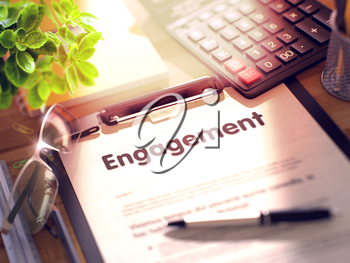 Engagement on Clipboard. Office Desk with a Lot of Office Supplies. 3d Rendering. Toned and Blurred Image.
