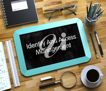 Identify And Access Management - Text on Small Chalkboard.Small Chalkboard with Identify And Access Management. 3d Rendering.