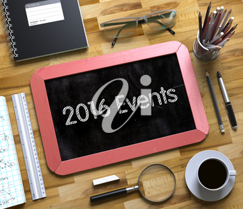 2016 Events Concept on Small Chalkboard. Top View of Office Desk with Stationery and Red Small Chalkboard with Business Concept - 2016 Events. 3d Rendering.
