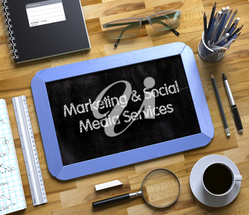 Marketing and Social Media Services - Blue Small Chalkboard with Hand Drawn Text and Stationery on Office Desk. Top View. Small Chalkboard with Marketing and Social Media Services. 3d Rendering.