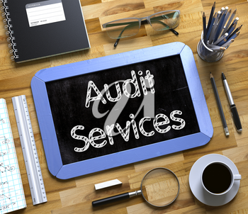 Audit Services - Blue Small Chalkboard with Hand Drawn Text and Stationery on Office Desk. Top View. Audit Services Handwritten on Small Chalkboard. 3d Rendering.