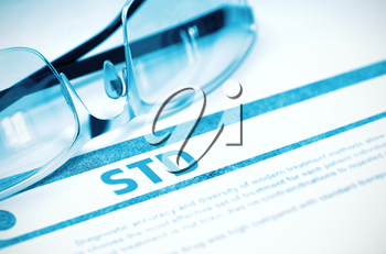 Diagnosis - STD - Sexually Transmitted Disease. Medical Concept with Blurred Text and Spectacles on Blue Background. Selective Focus. 3D Rendering.