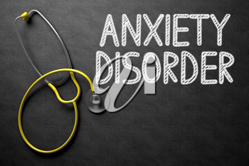 Medical Concept: Anxiety Disorder - Text on Black Chalkboard with Yellow Stethoscope. Medical Concept: Anxiety Disorder on Black Chalkboard. 3D Rendering.