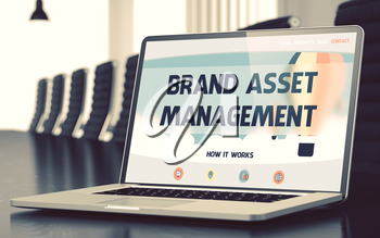 Brand Asset Management - Landing Page with Inscription on Mobile Computer Screen on Background of Comfortable Meeting Room in Modern Office. Closeup View. Toned Image. Blurred Background. 3D.