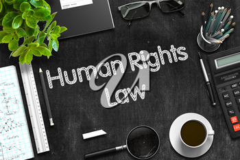 Human Rights Law Handwritten on Black Chalkboard. Top View of Black Office Desk with a Lot of Business and Office Supplies on It. 3d Rendering.