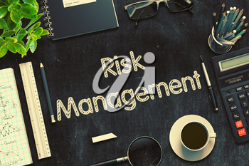 Top View of Office Desk with Stationery and Black Chalkboard with Business Concept - Risk Management. 3d Rendering. Toned Image.