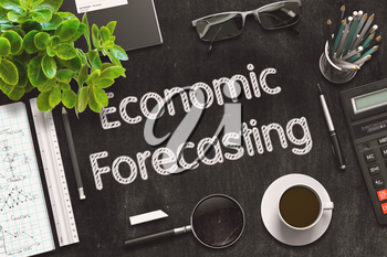 Economic Forecasting. Business Concept Handwritten on Black Chalkboard. Top View Composition with Chalkboard and Office Supplies. 3d Rendering. Toned Image.
