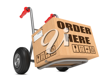 Cardboard Box with Order Here Slogan on Hand Truck Isolated on White.