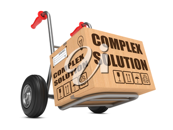 Complex Solution Slogan on Cardboard Box on Hand Truck White Background.