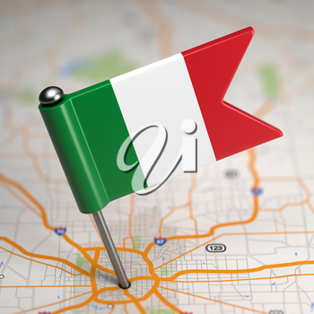 Small Flag of Italy Sticked in the Map Background with Selective Focus.