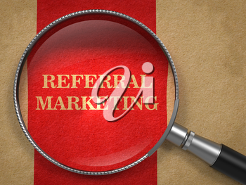 Referral Marketing Concept. Magnifying Glass on Old Paper with Red Vertical Line Background.