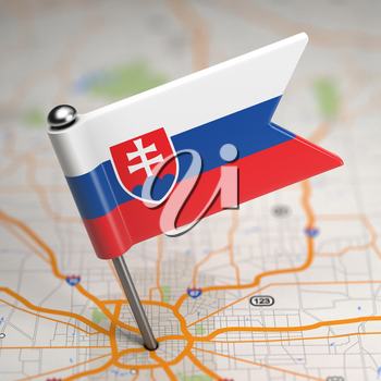 Small Flag of Slovakia on a Map Background with Selective Focus.