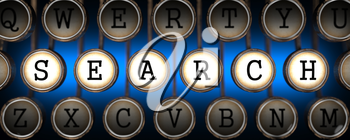 Search on Old Typewriter's Keys on Blue Background.
