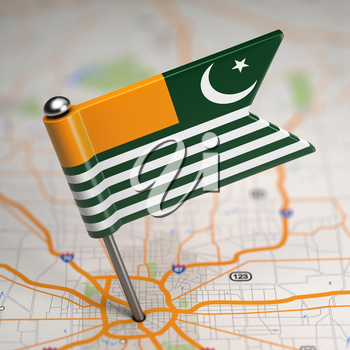 Small Flag of Azad Kashmir on a Map Background with Selective Focus.