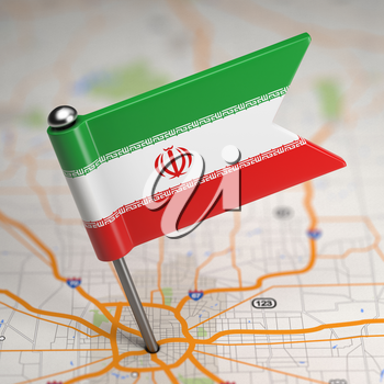 Small Flag of Islamic Republic of Iran on a Map Background with Selective Focus.
