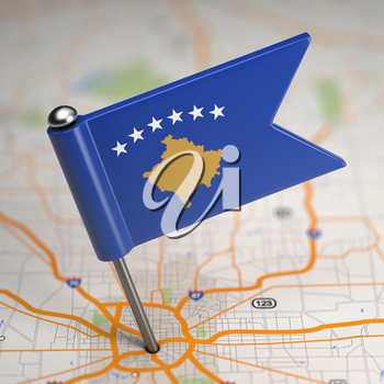 Small Flag of Republic of Kosovo on a Map Background with Selective Focus.