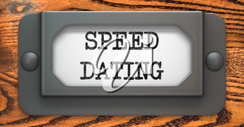 Speed Dating - Inscription on File Drawer Label on a Wooden Background.