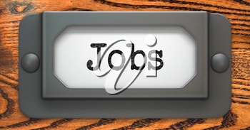 Jobs Inscription on File Drawer Label on a Wooden Background.