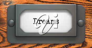 Dreams - Inscription on File Drawer Label on a Wooden Background.