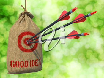 Good Idea - Three Arrows Hit in Red Target on a Hanging Sack on Green Bokeh Background.